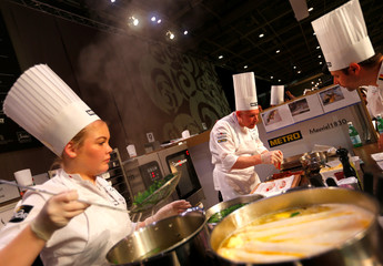 Belgian chef Peter Aesaert cooks with his teammates during the Bocuse d'Or chef competition in Budapest
