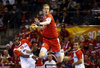 Denmark's Markussen attempts to score past Tunisia's Sanai during their Men's Handball World Championship match in Zaragoza