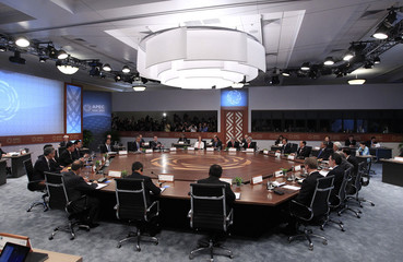 APEC leaders gather at the table during the first plenary meeting at the APEC Summit in Honolulu