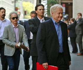 Donald Fehr arrives with players for meetings at the NHL offices in New York