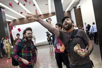 Austin Guest, an Occupy Wall Street protester, holds a demonstration inside the lobby of a JP Morgan building in New York's Financial District on the one-year anniversary of the Occupy Wall Street movement in New York