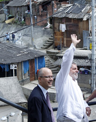 Brazilian President Luiz Inacio Lula da Silva waves during a visit to Dona Marta slum in Rio De Janeiro