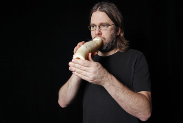 Austrian musician Jorg Piringer poses for a picture with a musical instrument made from vegetables in Haguenau, eastern France
