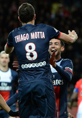 Paris Saint-Germain's Pastore celebrates with team mate Motta after scoring against Monaco during their French Ligue 1 soccer match at the Louis II stadium in Monaco