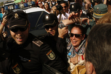 Spanish singer Pantoja is carried to a car after she collapsed while leaving a court after listening to the tribunal's sentence of her trial in Malaga
