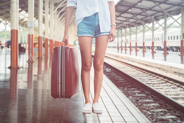 beautiful young asian girl traveling alone at train station, vintage tone
