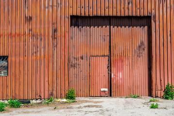 Rusted Metal Gate Warehouse