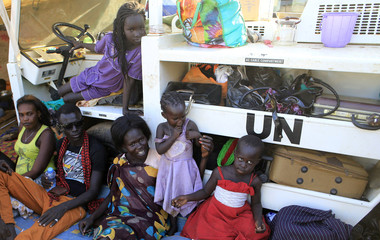 Displaced families are seen camped inside Tomping UN base near Juba international airport