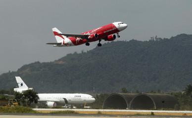 An AirAsia plane takes off at Vietnam's central Danang airport