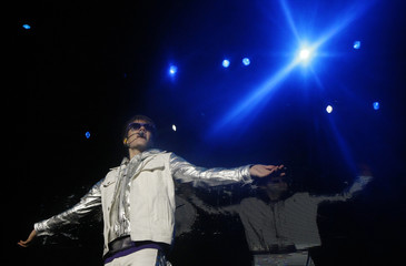 Canadian pop singer Justin Bieber performs on stage during his concert in Taipei