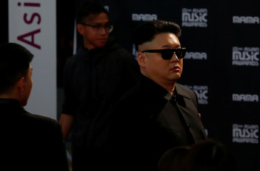 A man dressed as North Korean leader Kim Jong-un tries to enter the red carpet of Mnet Asian Music Awards in Hong Kong