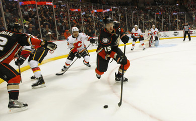 Anaheim Ducks center Ryan Getzlaf is chased by Calgary Flames right wing Jarome Iginla during their NHL hockey game in Anaheim