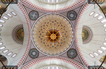 Decorated ceiling of Suleymaniye Mosque showing intersection of four domes with the main big dome, Istanbul, Turkey