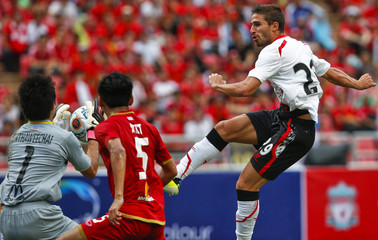 Liverpool's Borini kicks the ball against Thailand's National Team Hathairattanakul during a friendly soccer match at Ratchamangkala Stadium in Bangkok