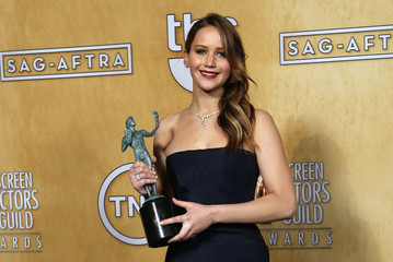Jennifer Lawrence hold her award backstage at the 19th annual Screen Actors Guild Awards in Los Angeles