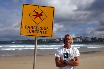 Australian surfer Owen Wright poses for a photograph on Bondi Beach in Sydney, Australia