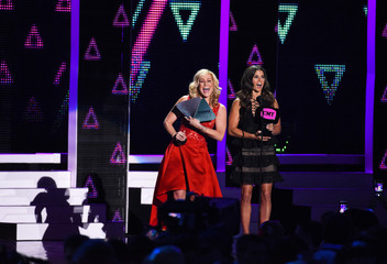 Danica Patrick and Kellie Pickler present an award during the 2016 CMT Music Awards in Nashville
