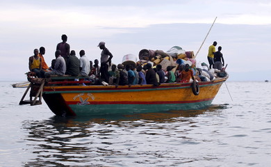 Burundian refugees sail on boat near the shores of Lake Tanganyika in Kagunga village in Kigoma region in western Tanzania to Kigoma township