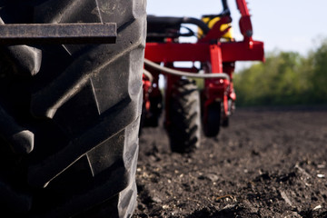 Agricultural machinery in a close-up field