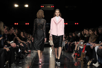 Models present creations by French designer Henry as part of his Fall-Winter 2013/2014 women's ready-to-wear for fashion show for house Carven during Paris fashion week
