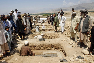 Graves are prepared for the burial of victims of roadside bomb in Laghman province