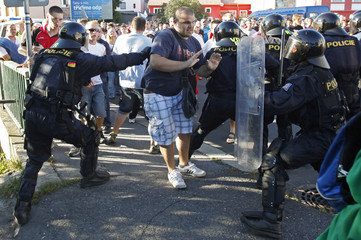 Czech riot police scuffle with protesters during an anti-Roma demonstration in Varnsdorf