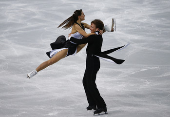 Germany's Tanja Kolbe and Stefano Caruso compete during the Figure Skating Ice Dance Short Dance Program at the Sochi 2014 Winter Olympics