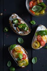Bruschetta with cherry tomatoes, cream cheese, mushrooms, basil