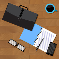 Top view of business, notebook and briefcase with documents
