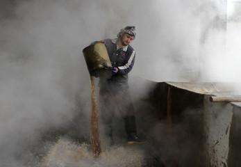 Afghan man works at a traditional yarn factory in Mazar-i-Shariff,