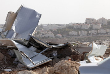 View shows the remains of a Palestinian dwelling after it was demolished by Israeli forces, as the Israeli West Bank settlement of Maale Adumim is seen in the background, near the West Bank village of Al-Eizariya