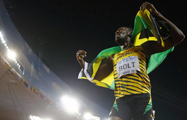 Usain Bolt of Jamaica celebrates after winning the men's 200 metres final during the 15th IAAF World Championships at the National Stadium in Beijing