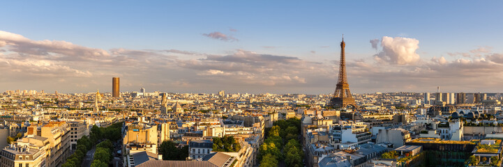 Zelfklevend Fotobehang Parijs Panoramic summer view of Paris rooftops at sunset with the Eiffel Tower. 16th Arrondissement, Paris, France