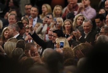 U.S. Speaker of the House Paul Ryan waves from the crowd as he attends the debate held by Fox Business Network for the top 2016 U.S. Republican presidential candidates in Milwaukee