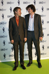 Canadian musicians Cuddy and his son Devin pose on the green carpet before the start of the Juno Gala Dinner and Awards in Regina