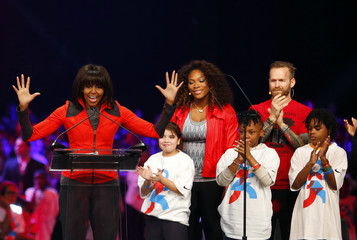 U.S. first lady Michelle Obama addresses a gathering of school students during an event to bring physical activity back to schools in Chicago