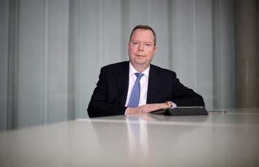 Terium, CEO of German utility RWE, poses at their headquarters in Essen