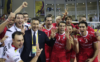 Italy's Trentino Head Coach Stoytchev of Bulgaria and players celebrate after winning the men's volleyball club world championship in Doha
