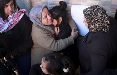 Relatives of Palestinian protester Malek Shahin mourn during his funeral in the West Bank Deheishe Refugee Camp, south of Bethlehem