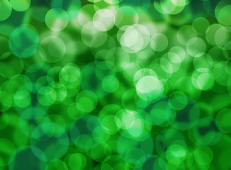 Abstract blurred background green bokeh lights.