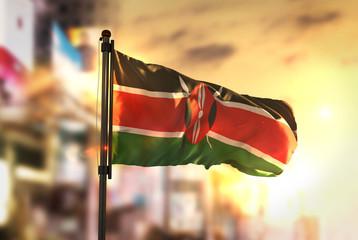 Kenya Flag Against City Blurred Background At Sunrise Backlight Wall mural
