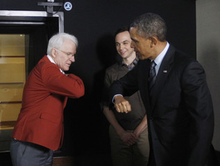 Obama bumps elbows with Steve Martin, as Jim Parsons looks on during Obama's tour of Dream Works in Glendale, California