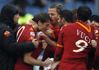 AS Roma's Totti is congratulated by his team mates after scoring against SS Lazio during their Italian Serie A soccer match in Rome