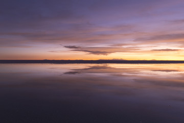 Gradient colour reflection at Uyuni salt flats in Bolivia.