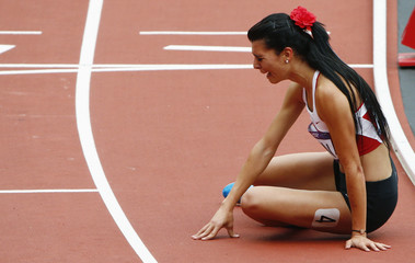 Turkey's Merve Aydin cries after she came in last in her women's 800m round 1 heat at the London 2012 Olympic Games at the Olympic Stadium