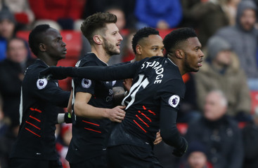 Liverpool's Daniel Sturridge celebrates scoring their first goal with team mates