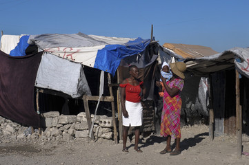 Haitians living in a camp for people displaced by the January 2010 earthquake are seen in Port-au-Prince