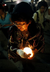 A Mexican woman takes part in a candlelight vigil on the first anniversary of the June 5, 2009 fire at a day care centre in Hermosillo, at the Angel of Independence Monument in Mexico City