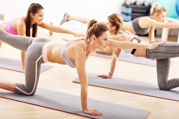 Young women working out in gym