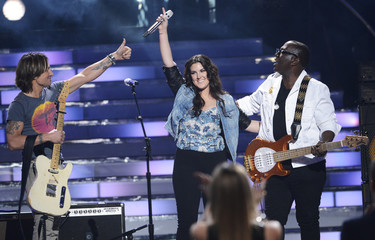 "Finalist Kree Hamilton reacts after performing ""Where the Blacktop Ends"" with judges Keith Urban and Randy Jackson during the Season 12 finale of ""American Idol"" in Los Angeles"
